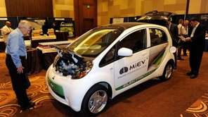 Attendees look at the 100 percent electric, zero-emission