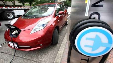 A Nissan Leaf charges at a electric vehicle