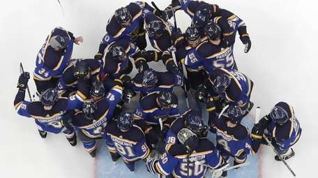 The St. Louis Blues celebrate after beating the