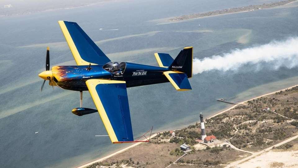 Aerobatic pilot David Windmiller flies over Long Island's