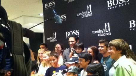 Jets quarterback Mark Sanchez poses with kids from