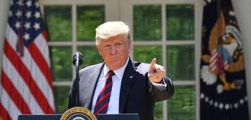 President Trump gestures as he delivers remarks on