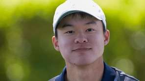 Adam Xiao of Manhasset takes a break during