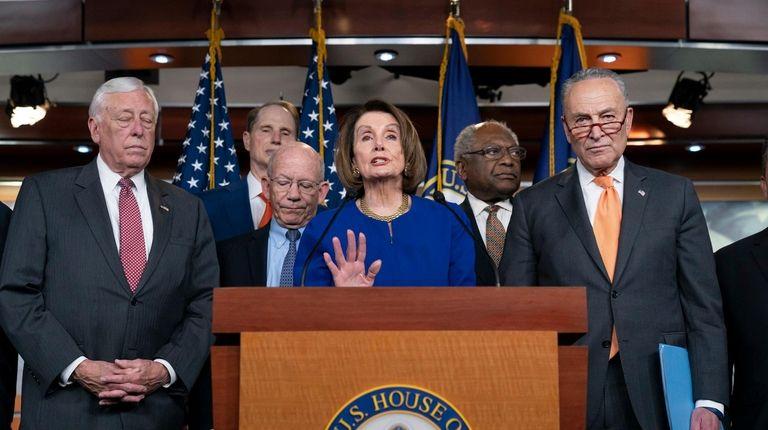 Speaker of the House Nancy Pelosi, D-Calif., center,
