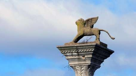 One of two winged lion statues that sits
