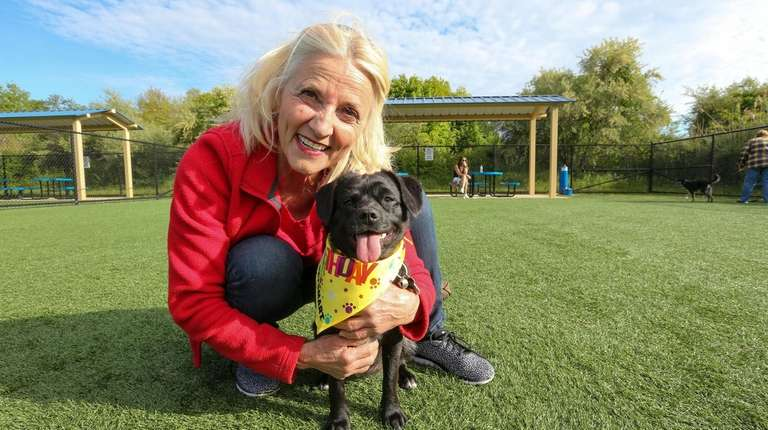 Kona, with owner Pat Voll at a meetup