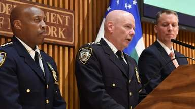 NYPD Chief of Department Terence A. Monahan, center,
