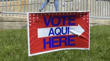 A voter outside the Wyandanch school district's administration