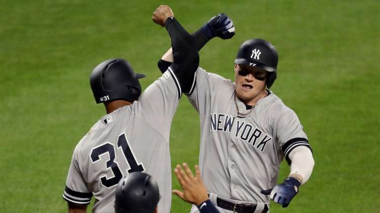 Clint Frazier of the Yankees celebrates his three-run
