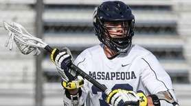 Sam Lutfi of Massapequa looks to pass against