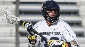 Sam Lutfi of Massapequa looks to pass against