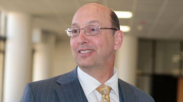 Defense attorney John Scarpa speaks to the media