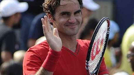 Roger Federer of Switzerland reacts after his win
