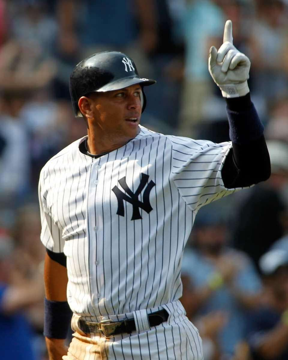 New York Yankees' Alex Rodriguez points to Robinson