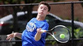 Port Washington's Alex Karman with the forehand return