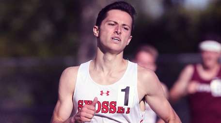 Justin DePinto of Syosset wins the boys 1,600-meter