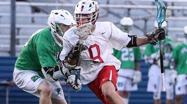 Syosset's Joe Bueti moves around Daniel McLoughlin of