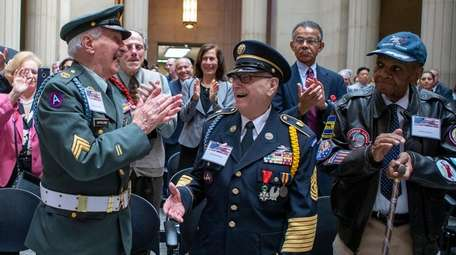 From left, Veterans Vincent DeMartino, Anthony Catalano, and