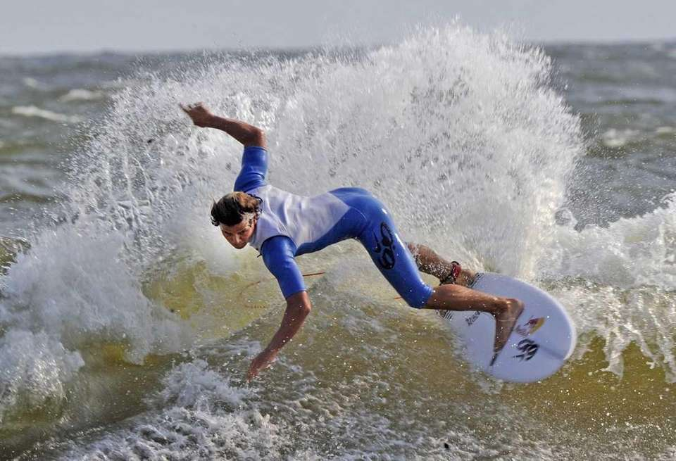 A surfer in the Quiksilver Pro surfing tournament