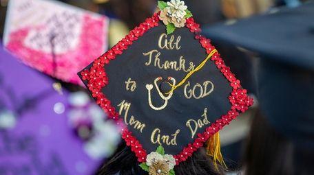 A graduate expresses gratitude on her cap Wednesday
