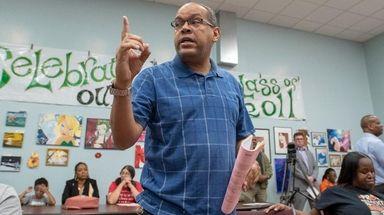 Robert Beato speaks Wednesday at the Wyandanch school