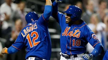 Rajai Davis of the Mets celebrates his eighth-inning