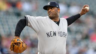 The Yankees' CC Sabathia pitches during the first