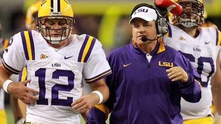 Head coach Les Miles with Jarrett Lee #12