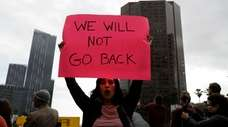 A demonstrator shouts slogans during a rally in