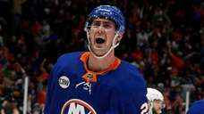 Islanders center Brock Nelson celebrates after scoring a