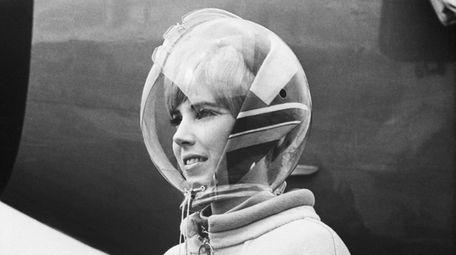 A spacelike helmet of transparent plastic was part
