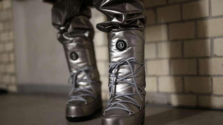 Space-age style boots are displayed at the Bogner