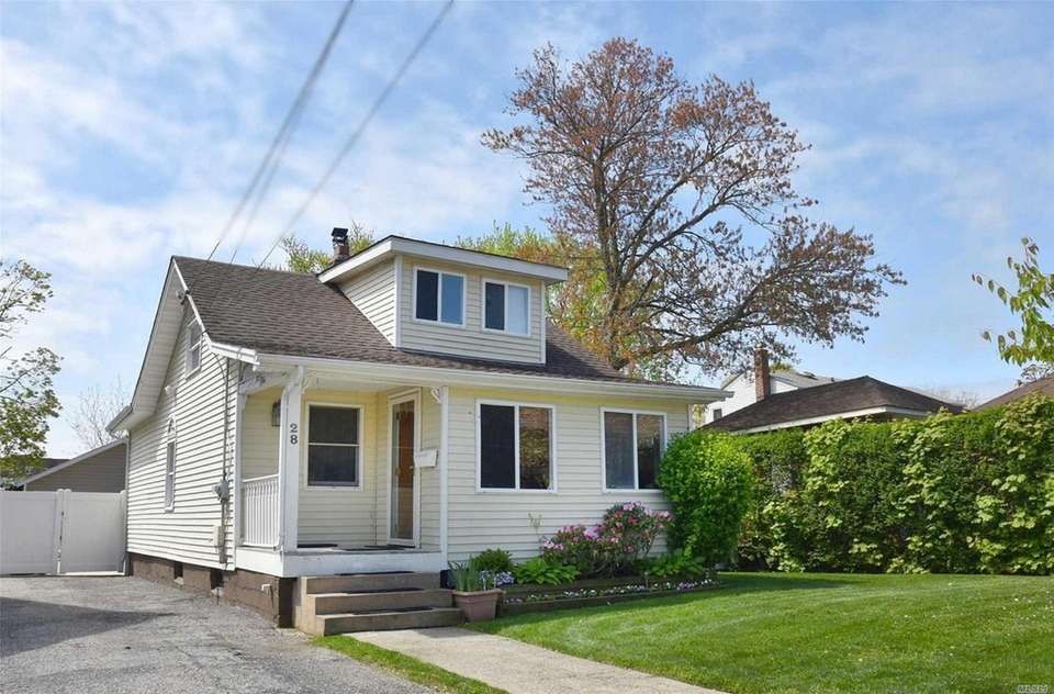 This Lynbrook bungalow features two bedrooms and one