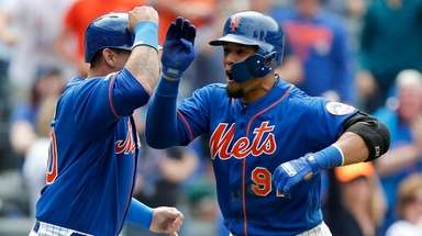 Mets outfielder Carlos Gomez celebrates his three-run home