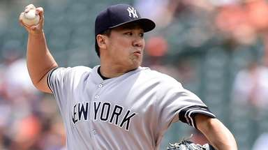 Yankees starter Masahiro Tanaka pitches in the first