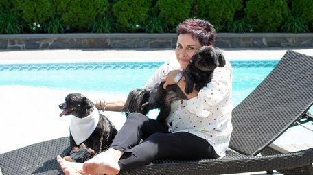 Patricia Schneider holds her dog Libby, alongside other