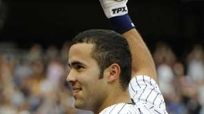 New York Yankees' Jesus Montero gestures to fans