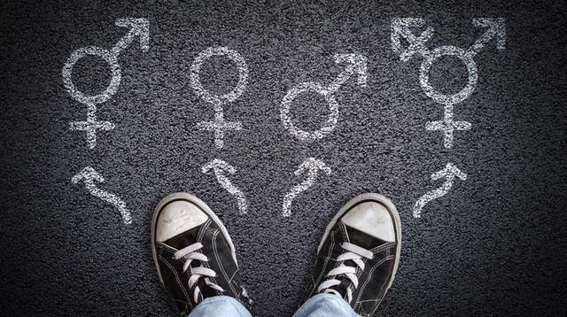 A person standing on asphalt road with gender