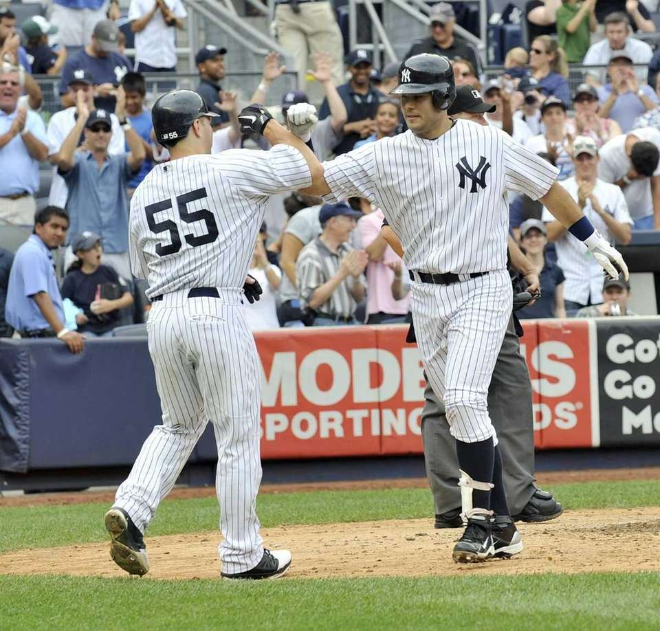 Jesus Montero, right, gets a forearm bash from