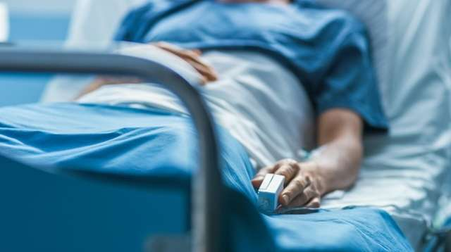In the Hospital Sick Male Patient Sleeps on