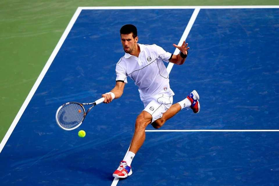 Novak Djokovic of Serbia returns a shot against