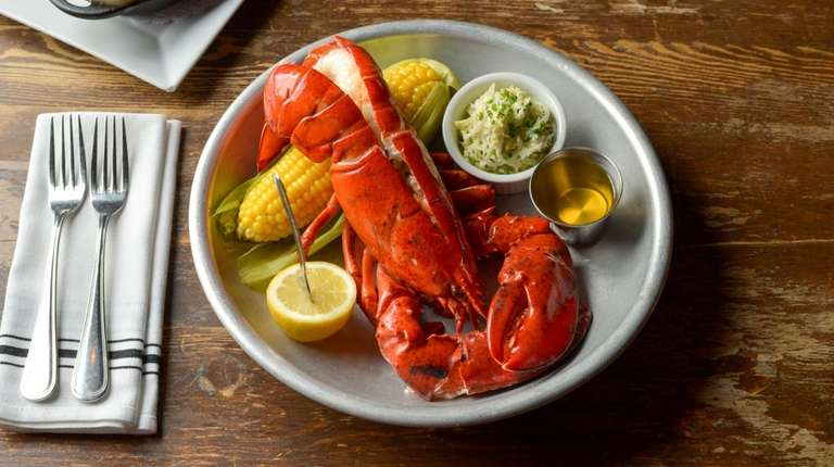 The whole steamed Maine lobster is served with