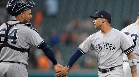 The Yankees' Gleyber Torres, right, and Gary Sanchez