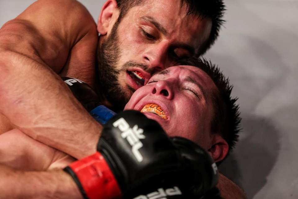 Gadzhi Rabadanov goes for the rear-naked choke against
