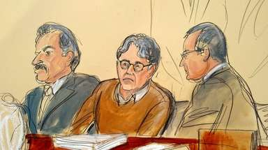 Courtroom drawing showing Keith Raniere seated between his