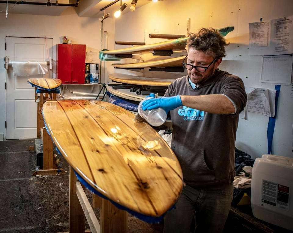 Grain Surf Shop owner Brian Schopfer working on