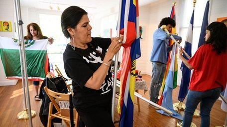 Margarita Espada helps prepare Latin American flags that