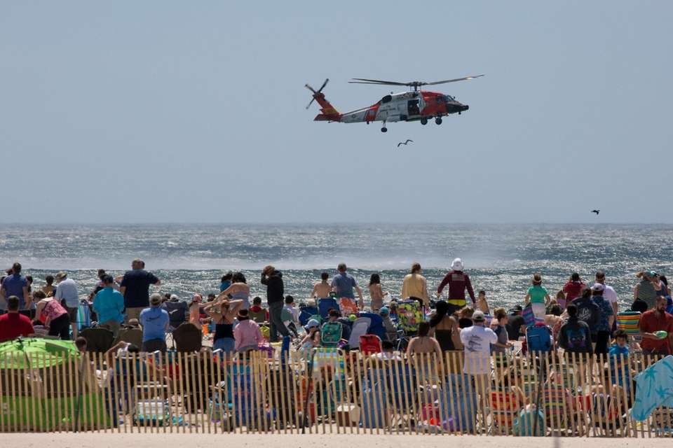 A U.S. Coast Guard helicopter hovers over the