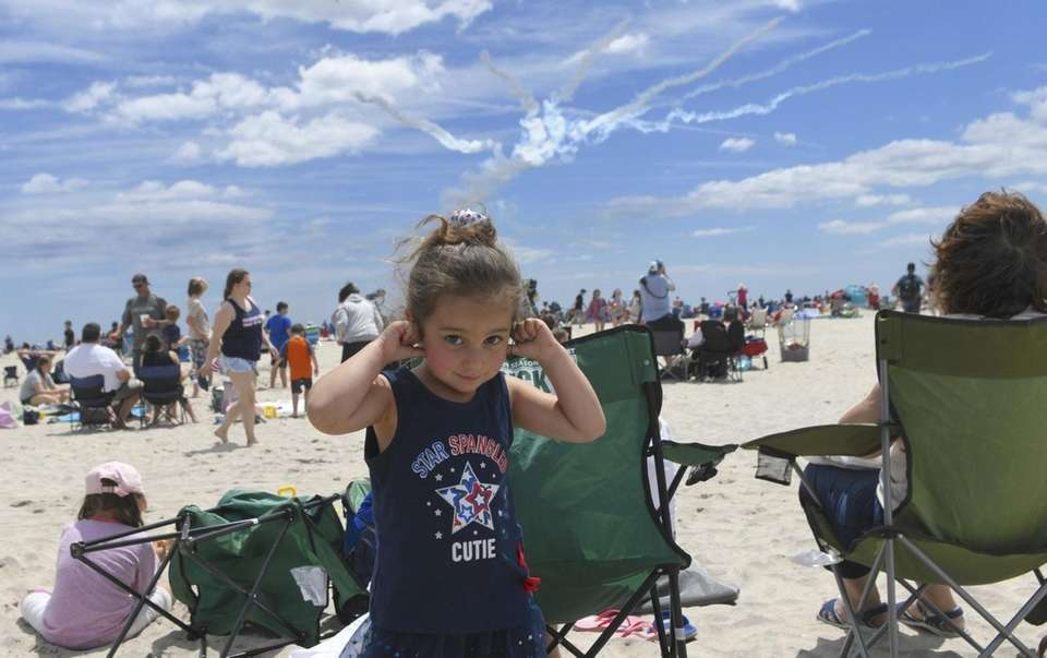 Rebekkah Arias, 4, of Farmingdale, plugs her ears