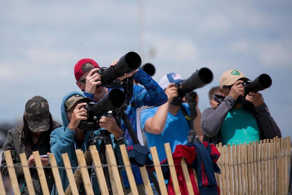 Photographers train their lenses on the GEICO Skytypers